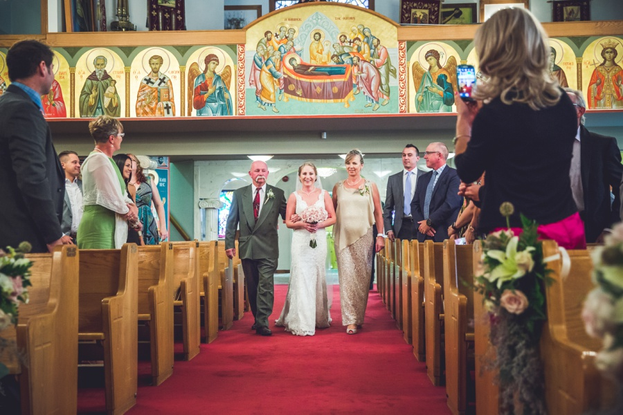 bride walking down aisle with parents St. Demetrios Greek Orthodox Church calgary