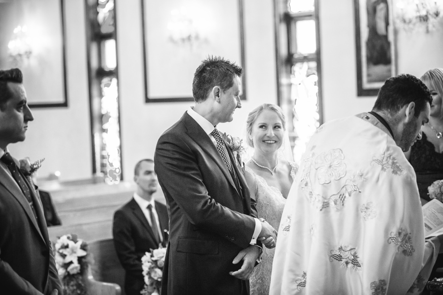 bride groom smiling St. Demetrios Greek Orthodox Church calgary