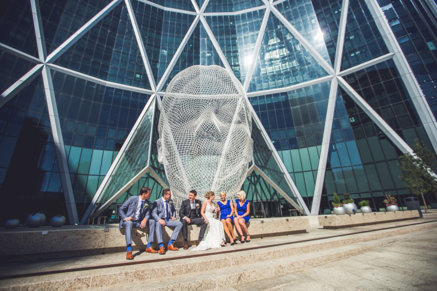 calgary wedding photographer bridal party in front of the bow wonderland statue