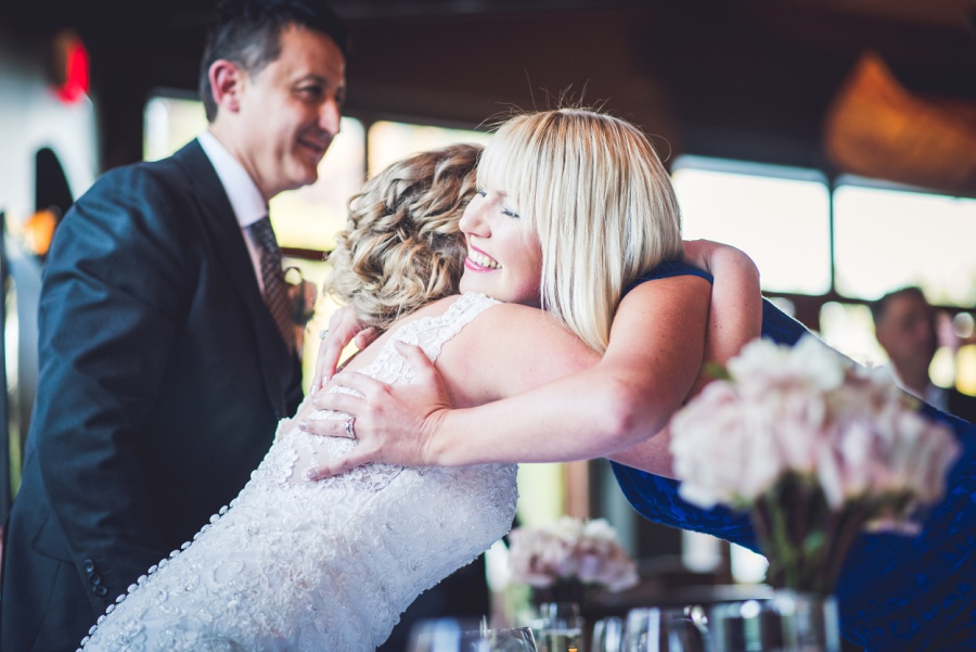 River Cafe Calgary Wedding bridesmaid hugging bride