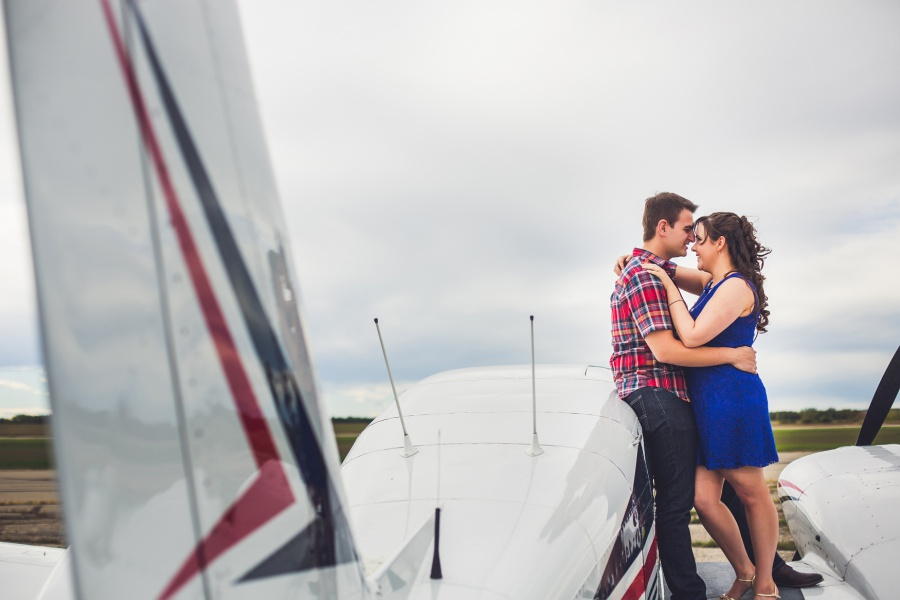 calgary engagement photos with small airplane blue dress