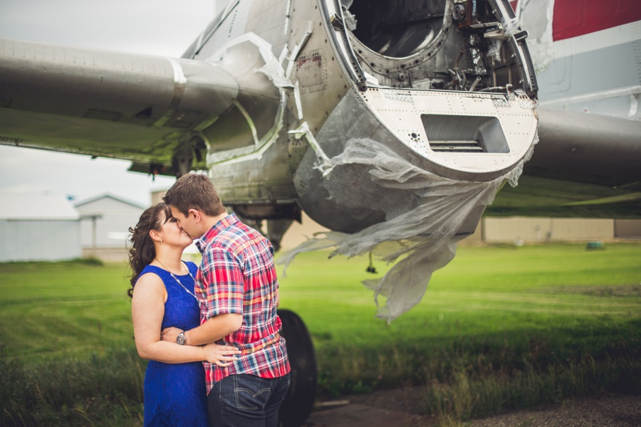 calgary engagement photos abandoned plane plaid shirt