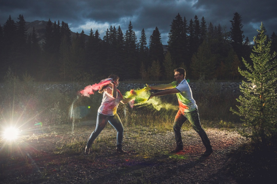 canmore engagement photos holi powder throwing off camera flash