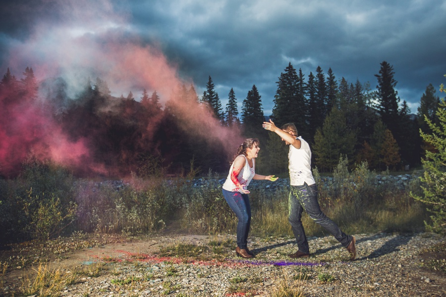 canmore engagement photos holi powder throwing pink color