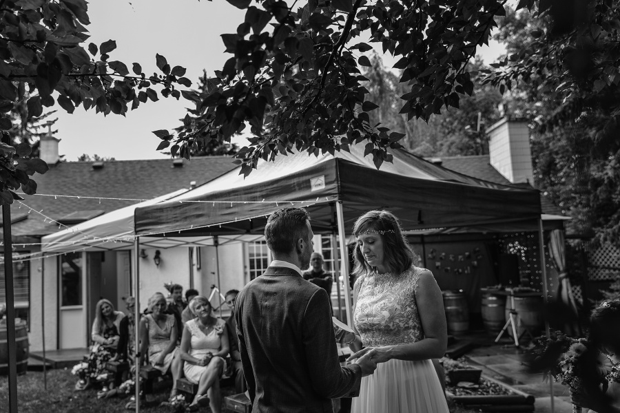 calgary backyard wedding bride reading vows