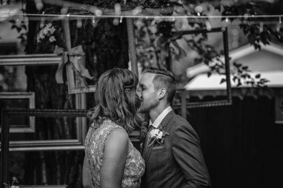 calgary backyard wedding first kiss ceremony