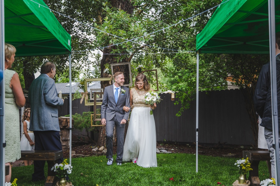 calgary backyard wedding bride groom walking down aisle