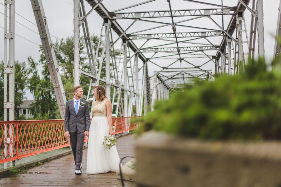 train bridge bride groom walking calgary backyard wedding