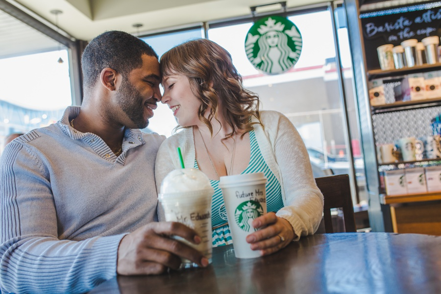 calgary starbucks engagement photos cute mixed race couple with coffee cups