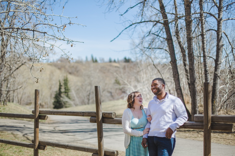 cute mixed race couple laughing calgary engagement photos