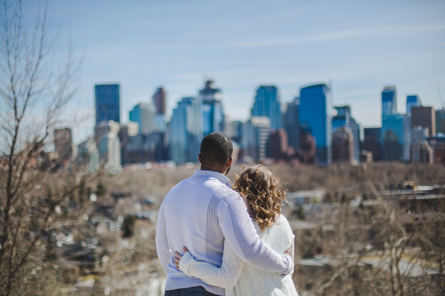 couple looking downtown skyline mixed race engagement photos calgary