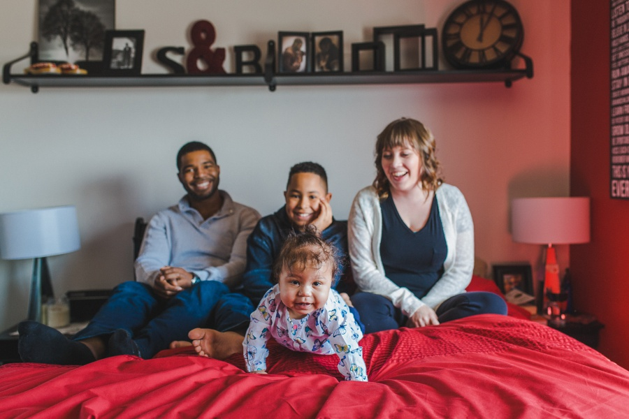 mixed race couple with family calgary engagement photos