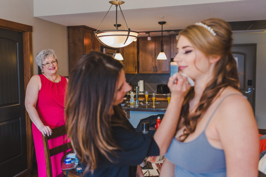 Bride getting ready with mother Winter Mountain Canmore Wedding