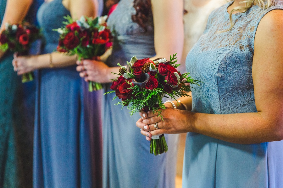 bridesmaid blue dress red rose bouquet Winter Mountain Canmore Wedding
