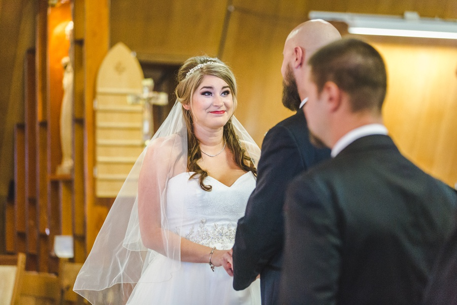Winter Mountain Canmore Wedding bride smiling at groom