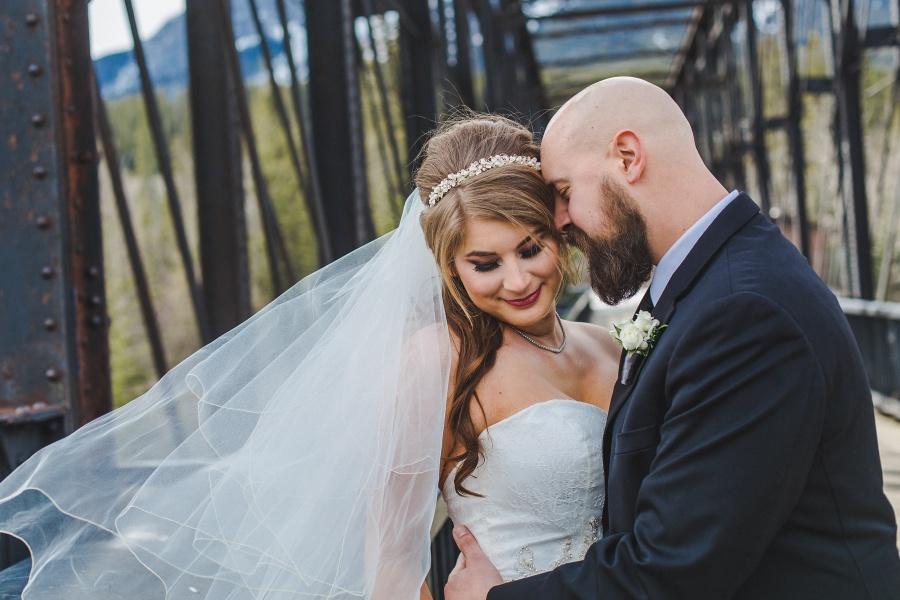 bride groom on engine bridge Winter Mountain Canmore Wedding