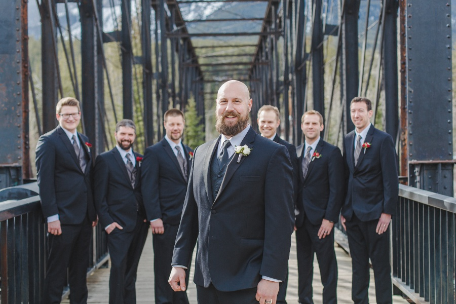 bearded groom with groomsmen Winter Mountain Canmore Wedding