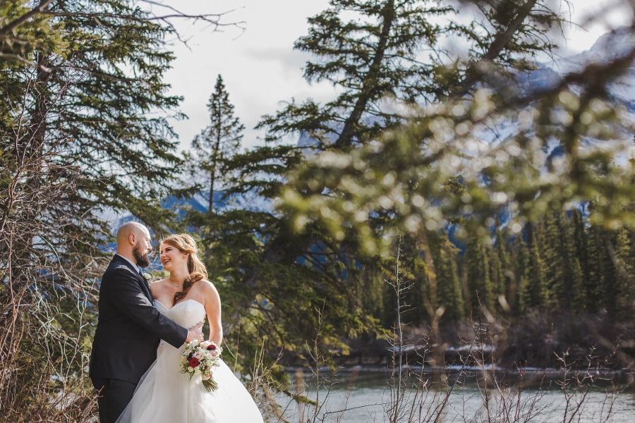 bride groom smiling mountains Winter Mountain Canmore Wedding
