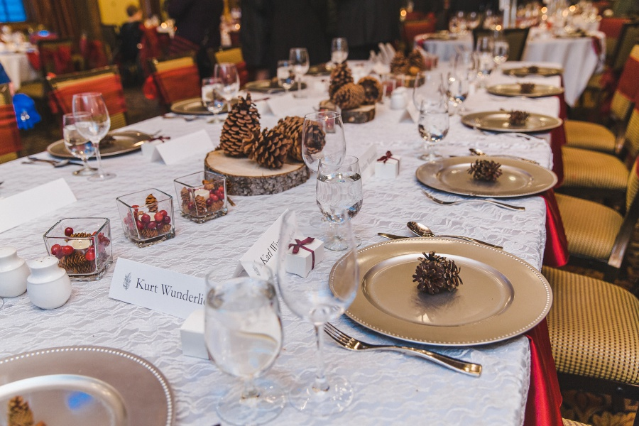 Winter Mountain Canmore Wedding Silvertip Resort pinecone place setting decor