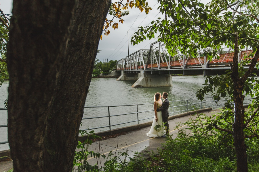calgary backyard wedding bride groom by river