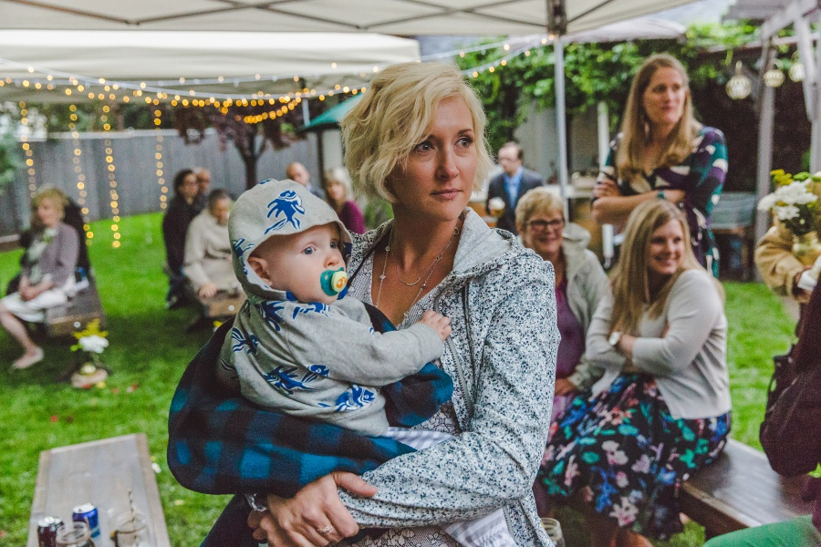guest with baby calgary backyard wedding