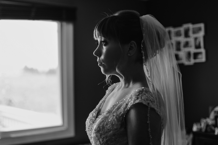 bride getting ready at home calgary wedding photographer