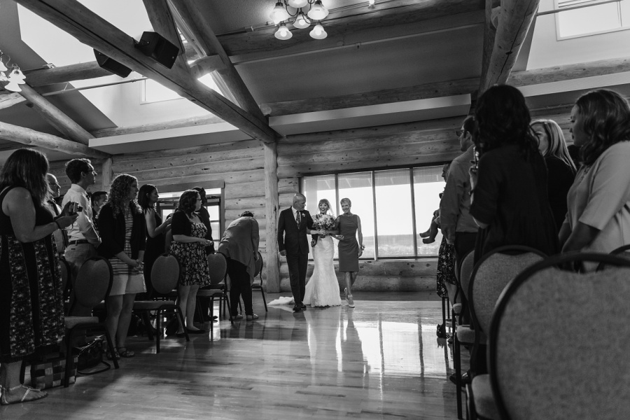 cochrane ranchehouse wedding calgary bride walking down aisle
