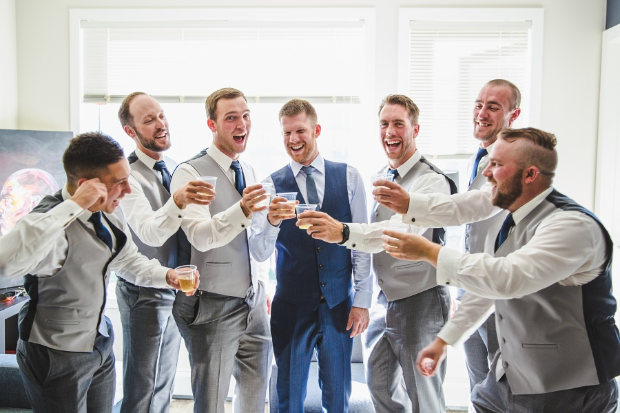 groomsmen cheers groom blue suit calgary wedding photographers