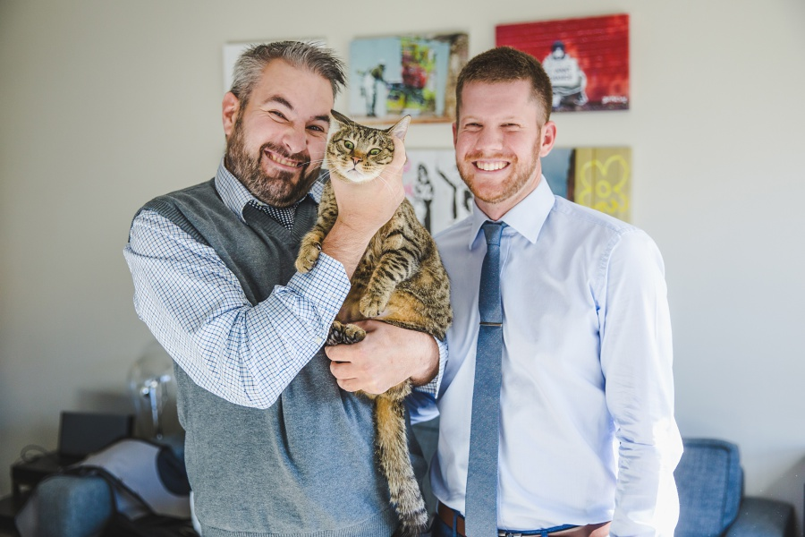 groom with cat blue shirt tie calgary wedding photographer