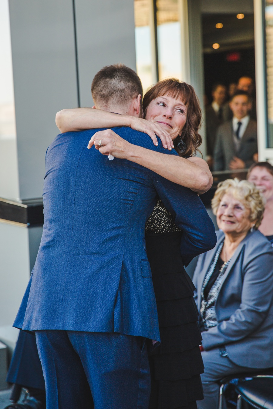 Le Germain Calgary Rooftop Wedding mother of groom crying