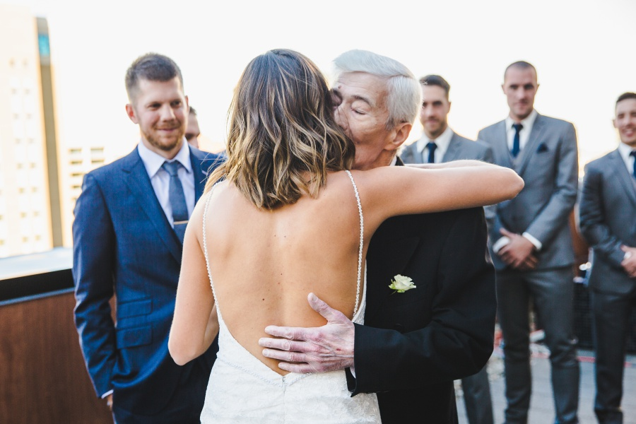 Le Germain Calgary Rooftop Wedding father of bride kiss