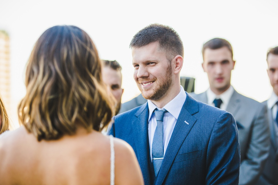 Le Germain Calgary Rooftop Wedding groom blue suit with tie