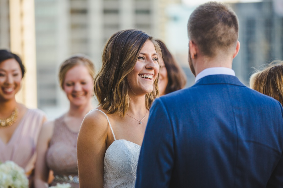 bride laughing Le Germain Calgary Rooftop Wedding
