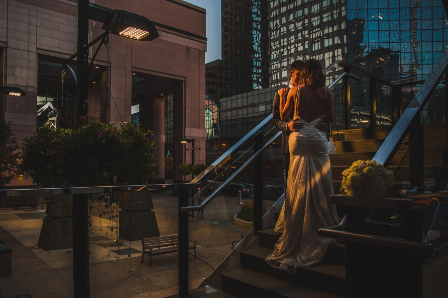 Le Germain Calgary Rooftop Wedding bride on stairs groom downtown
