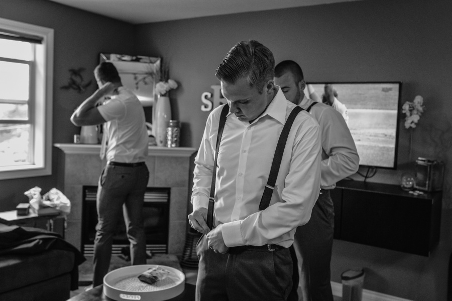 groom getting ready calgary white shirt suspenders