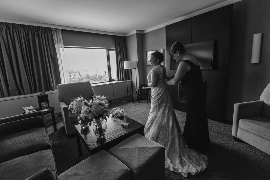 black and white bride getting ready in wedding dress calgary