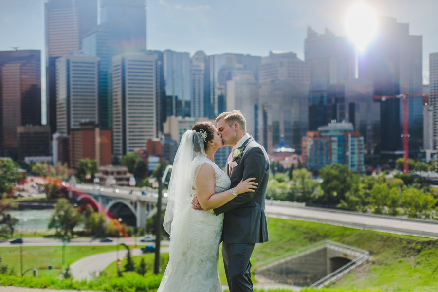 calgary rotary park wedding bride groom kiss skyline downtown view