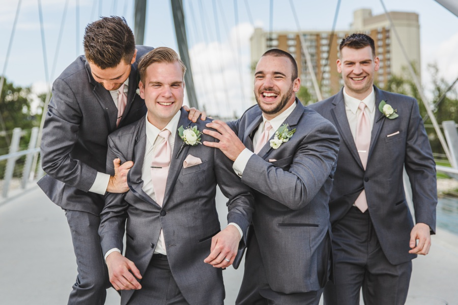 groom groomsmen grey suit pink ties calgary wedding photographer