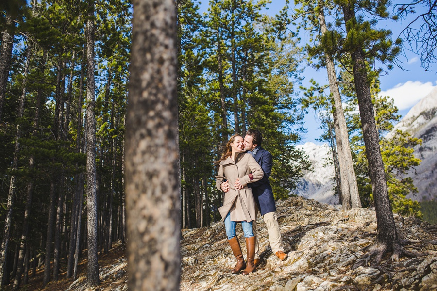 lake minnewanka banff engagement photos in the fall forest trees