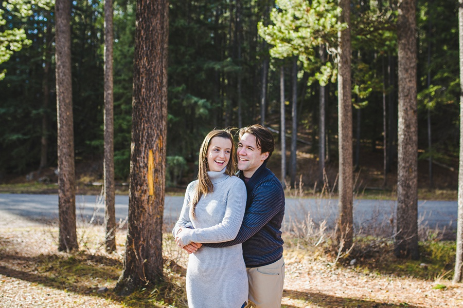 lake minnewanka banff engagement photos in the fall forest views
