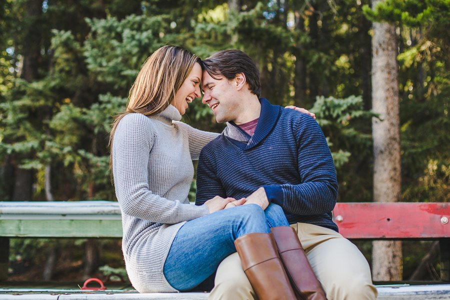 lake minnewanka banff engagement photos in the fall laughter cute couple
