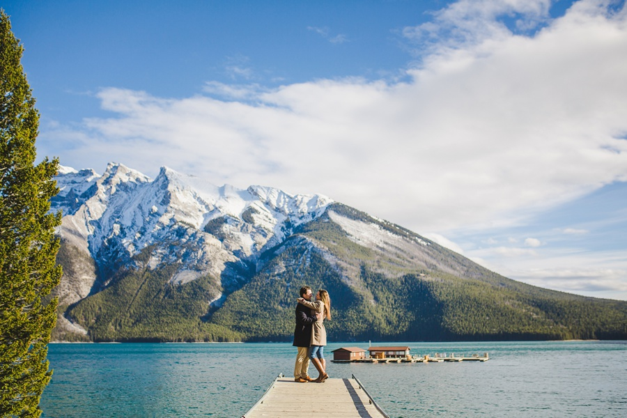 lake minnewanka banff engagement photos in the fall wood bridge lake view