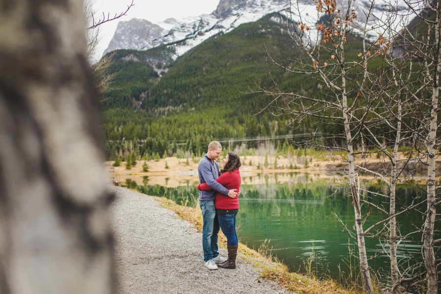 quarry lake canmore engagement photos couple by emerald water