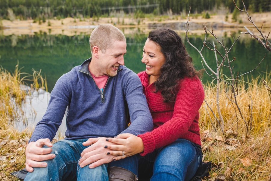 quarry lake canmore engagement photos cute couple cuddling