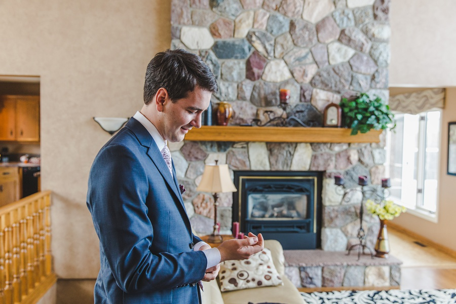 calgary wedding photographers groom grey suit