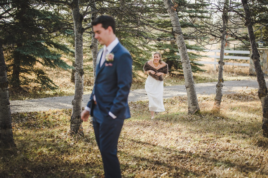 calgary wedding photographers bride groom first look forest