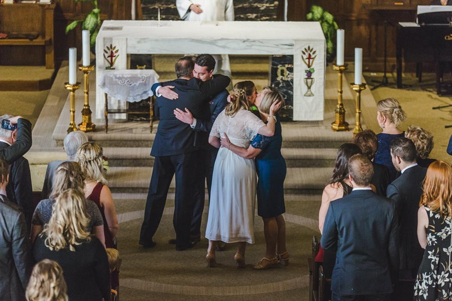 calgary wedding photographers St Joseph Catholic Church parent kisses