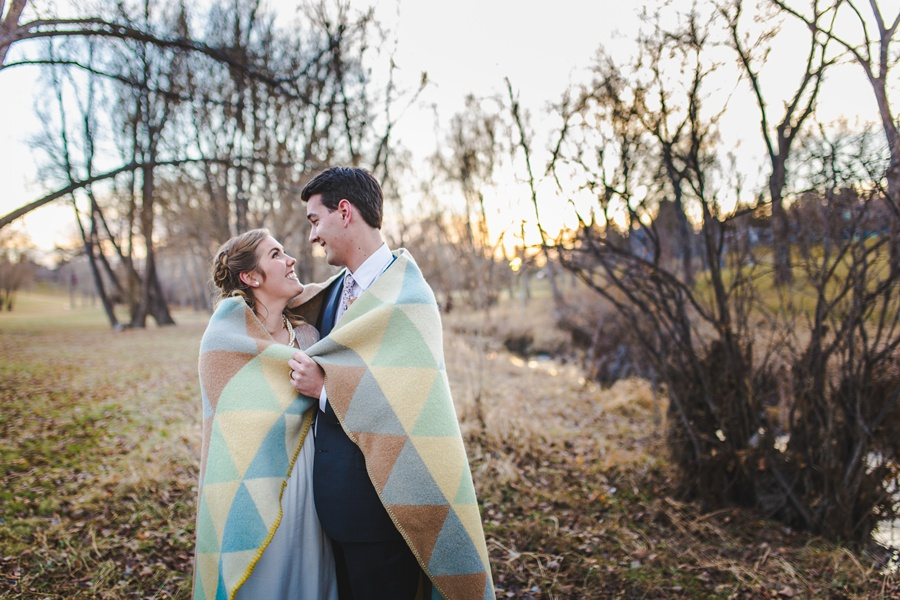 calgary wedding photographers winter wedding blanket cuddle