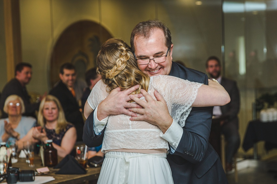 big rock brewery calgary wedding father hug bride