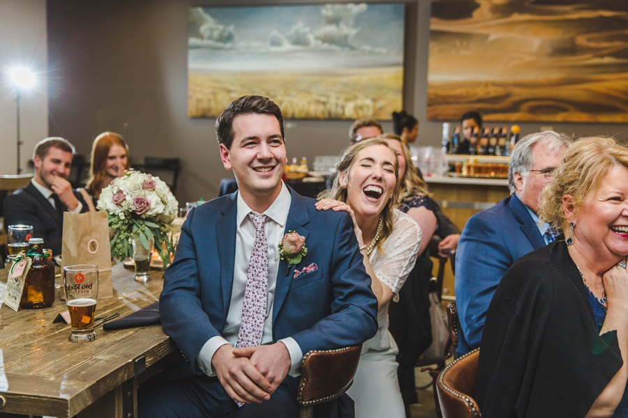 big rock brewery calgary wedding bride groom laughing